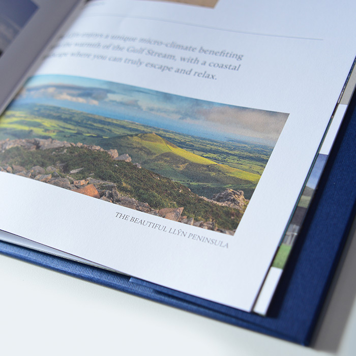 Close up of the Natural Land brochures designed by Eclectic Creative